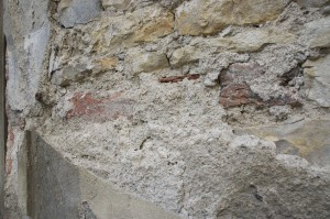 Crumbling plaster and roughly cut stone